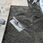 Aanhelen natuursteen vloer in specie